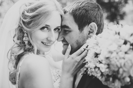 Perfect couple bride, groom posing and kissing in their wedding day