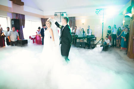 First wedding dance of newlywed couple in restaurant Stock Photo
