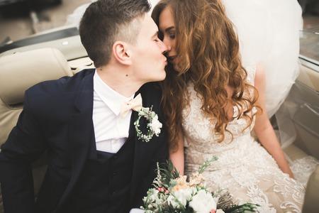 Happy bride and groom posing after wedding ceremony