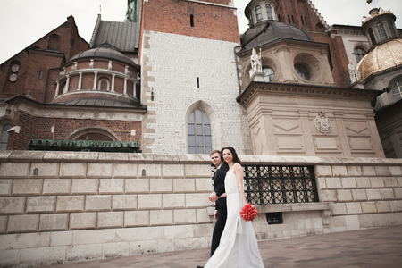 Wedding couple, bride and groom walking near a church in Krakow 写真素材
