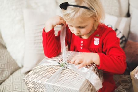 Portrait of cute little beautiful girl with gift box