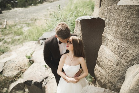 beautiful wedding couple in the mountains with rocks