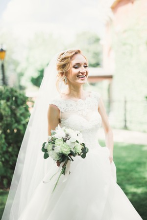 Bride holding big and beautiful wedding bouquet with flowers Stock Photo