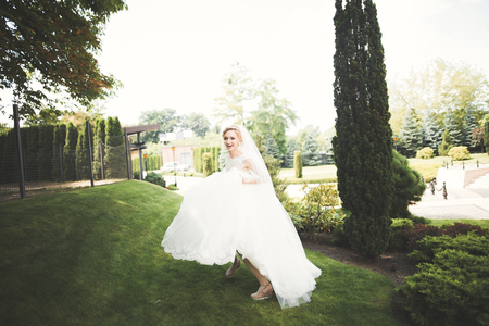 Beautiful bride posing in wedding dress outdoors Stok Fotoğraf