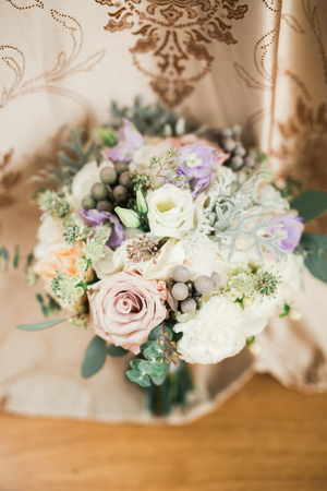 Beautiful wedding bouquet with different flowers, roses