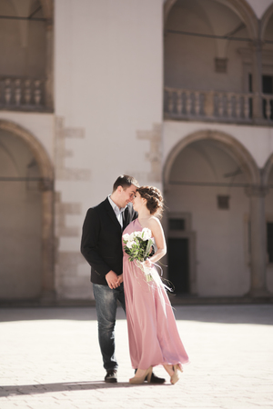 Beautiful couple, man, girl with long pink dress posing Stock Photo