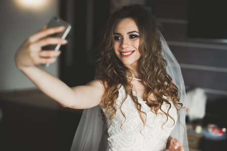 Beautiful bride making selfie in the home before wedding
