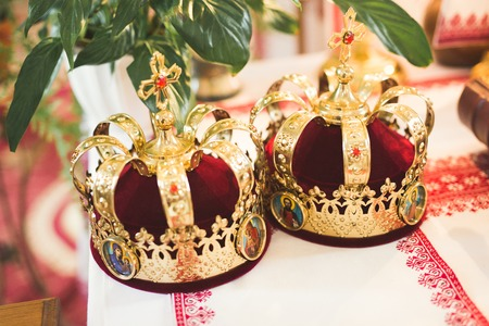 Golden crowns lying on the table in church 写真素材