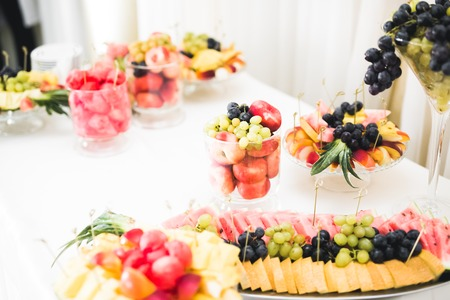 Delicious sweets on wedding candy buffet with desserts, cupcakes Stock Photo - 113496902