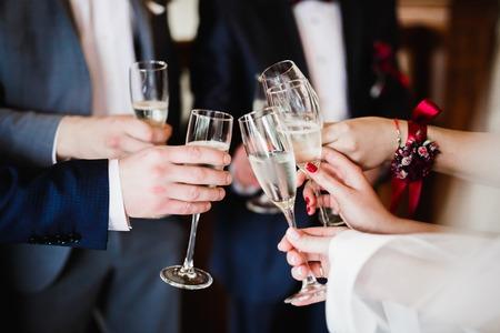 Gorgeous wedding couple enjoys champagne in the ceremony.