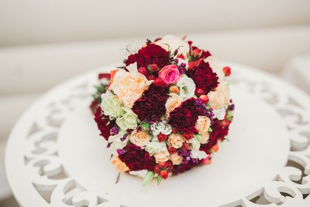 Beautiful wedding bouquet with different flowers, roses Standard-Bild