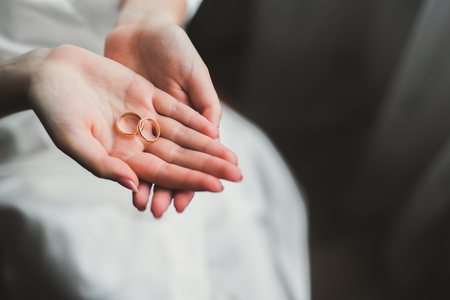Luxury wedding rings on bride hands. Close focus