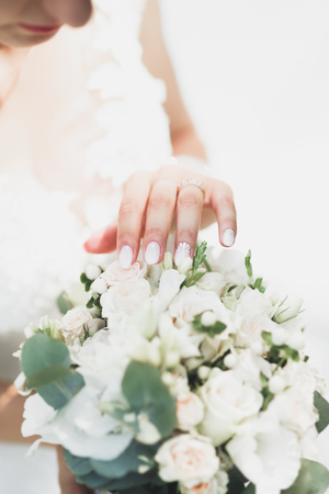 Newly wed couples hands with wedding rings Stock Photo