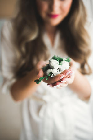 Bride holding big and beautiful wedding bouquet with flowers 写真素材