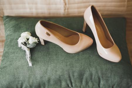 White stylish wedding shoes for bride. Close-up