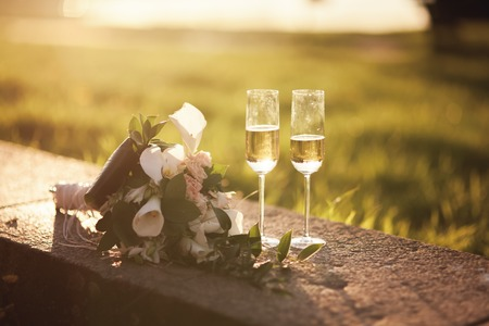 wedding bouquet and two glasses with champagne