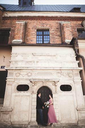 Elegant beautiful wedding couple posing near a church. Krakow
