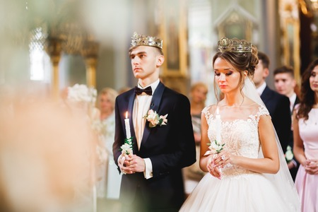 Wedding couple bide and groom get married in a church Stok Fotoğraf - 118761510