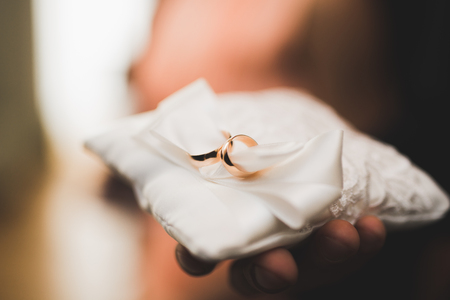 Wedding rings on ceremony at church. Macro