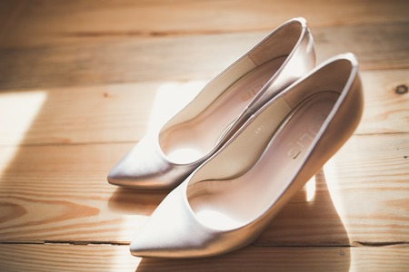 White stylish wedding shoes for bride. Close-up. Imagens