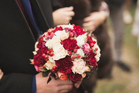 Wonderful luxury wedding bouquet of different flowers