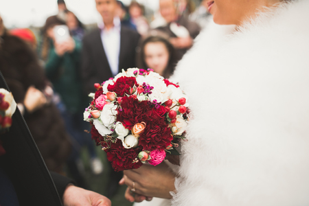 Bride holding big and beautiful wedding bouquet with flowers Imagens