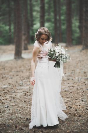 Beautiful bride posing in wedding dress outdoors 版權商用圖片