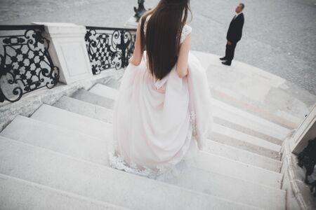 Luxury married wedding couple, bride and groom posing in luxury city. Stock Photo