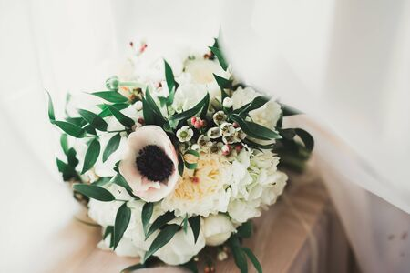 Beautiful wedding bouquet with different flowers, roses.