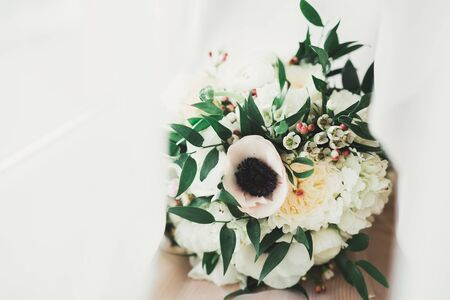 Wonderful luxury wedding bouquet of different flowers.