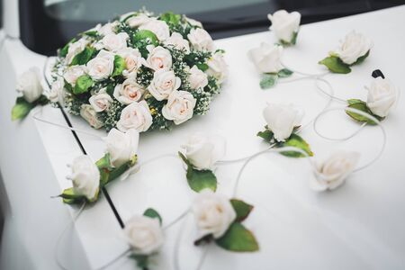Wedding car decorated with beautiful, luxury flowers.