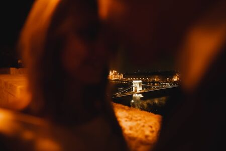 Kissing wedding couple staying over beautiful landscape Banco de Imagens