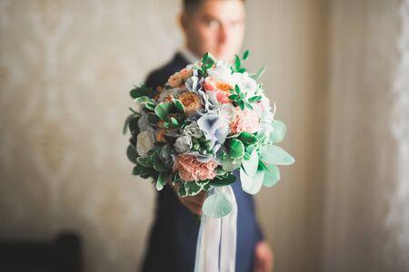Beautiful man, groom posing and preparing for wedding.