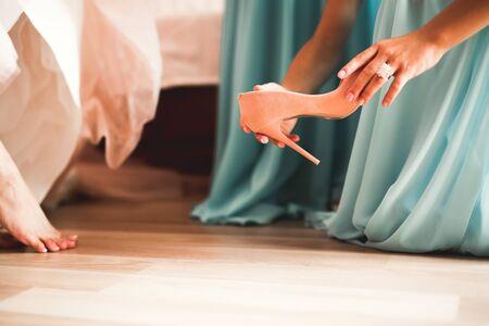 White stylish wedding shoes for bride. Close-up. Banco de Imagens