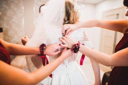 Bride with bridesmaids on the wedding day. Banco de Imagens