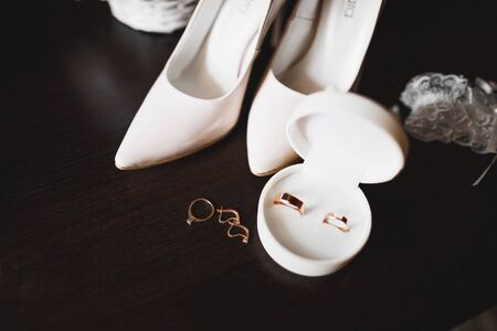 Beautiful toned picture with wedding rings and wedding shoes Banco de Imagens