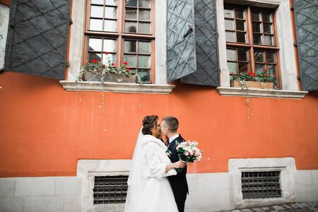 Gorgeous happy couple standing close to each other and looking in eyes. Stock fotó