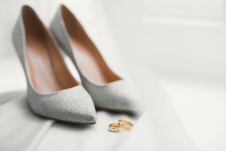 Beautiful toned picture with wedding rings and wedding shoes Stock fotó