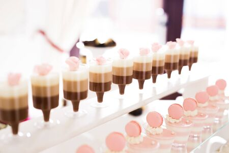 Delicious sweets on wedding candy buffet with desserts, cupcakes. Stock fotó