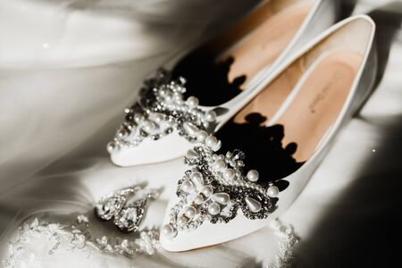 Brides wedding shoes and costume jewellery.