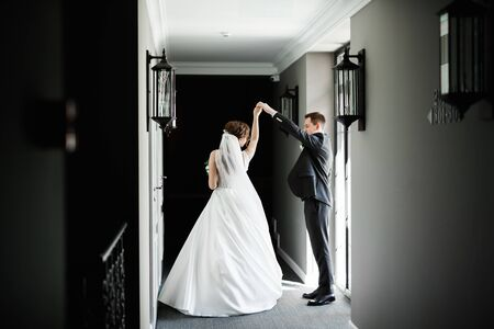 Happy beautiful newlyweds dancing.
