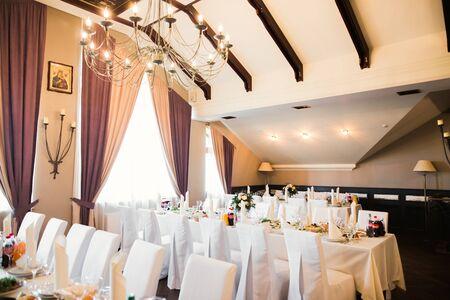 Interior of a restaurant prepared for wedding ceremony. Stock fotó