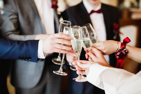 Gorgeous wedding couple enjoys champagne in the ceremony