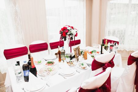 Interior of a restaurant prepared for wedding ceremony
