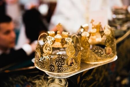 Golden crowns lying on the table in church.
