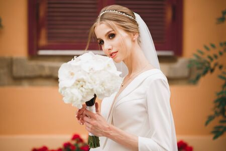 Portrait of a beautiful fashion bride, sweet and sensual. Wedding make up and hair