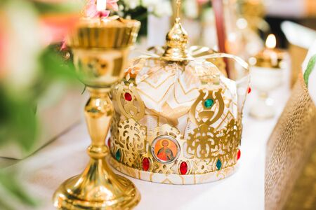 Golden crowns lying on the table in church Imagens