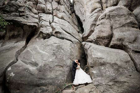 Loving husband and woman on the background of the mountains. Loving couple emotionally spends time