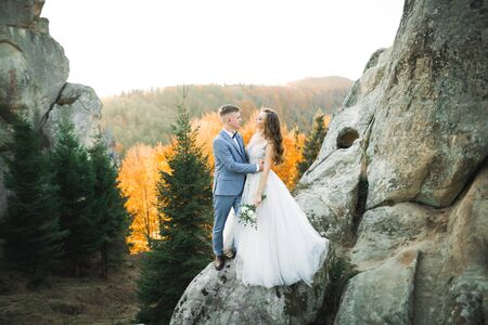 Loving husband and woman on the background of the mountains. Loving couple emotionally spends time. Stock Photo