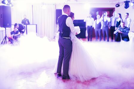 Beautiful wedding couple just married and dancing their first dance.